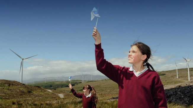 Patricia O'Shea and Siobhan Dillon from Kilgarvan national School (Co. Kerry) at their local wind farm. Photo: Don MacMonagle